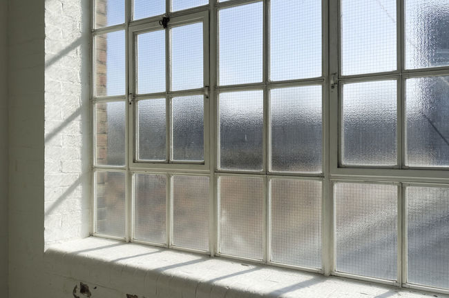 Old fashioned Steel Framed Window with Frosted Safety Glass Fashion Architecture Building Day Fashioned Frame Frosted Glass Glass Indoors  Interior Metal No People Old Steel Style Vintage Warehouse Window