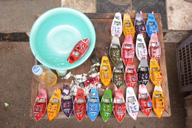 High Angle View Of Traditional Toy Boats With Tub Of Water
