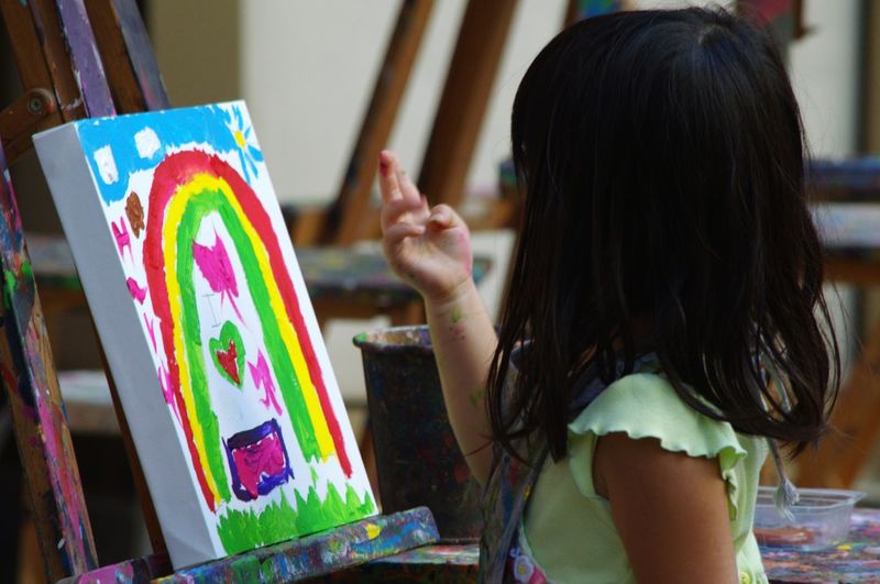 Girl painting on chart paper