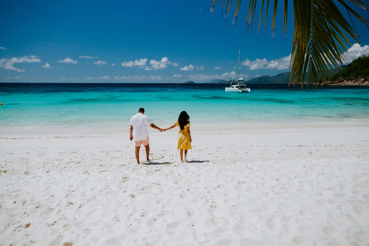 couple relax on beach resort in tropics. Luxury travelling together. Seychelles. Couple Couple - Relationship Beach Summer Sun Togetherness Love Resort Island Tropical Ocean Sea Relaxing Travel Travel Destinations Leisure Activity Lifestyles Exotic Seychelles Vacations Honeymoon EyeEm Best Shots Happiness