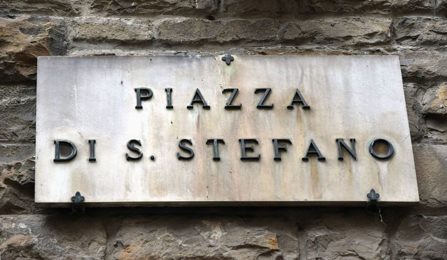 Piazza di S. Stefano, Florence, Italy Piazza Di S. Stefano Street In Florence Street Signs Architecture Building Exterior Built Structure City Details Close-up Communication Day Florence Historic Sign Historic Signs No People Outdoors Piazza In Florence Stone Wall Stone Walls Street Sign Streetsign Text Wall - Building Feature