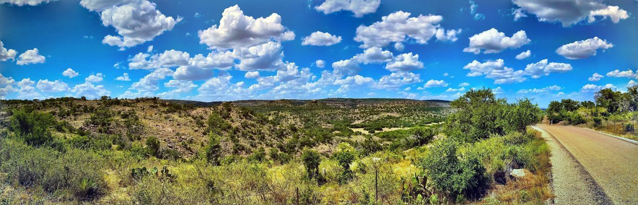 Panorama looking off the Edwards Plateau Escarpment onto the Lano Basin Tranquility Nature Tranquil Scene Scenics Landscape Sky Day Blue Beauty In Nature Cloud - Sky Outdoors Tree No People Road Plant Growth