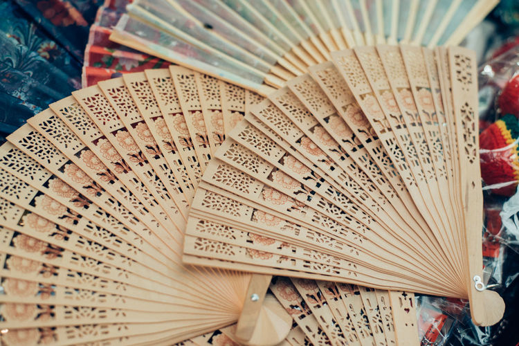 Folding Fan Hand Fan Text Close-up Focus On Foreground Script High Angle View Still Life Non-western Script Communication Art And Craft Pattern No People Foldable Indoors  Craft Book Publication Day Personal Accessory