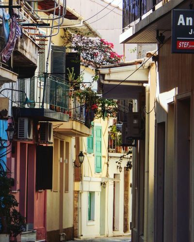 Into alleys Lefkada Island Greece AlleyShots Alleys Architecture Building Exterior Built Structure Building City Residential District No People Day Outdoors Nature Low Angle View Sunlight Street Window House Plant Summer Road Tripping