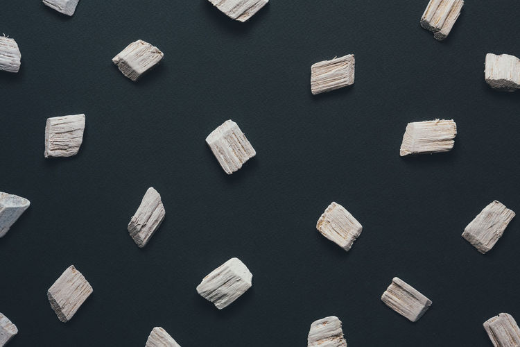Full frame shot of wooden pieces on gray background