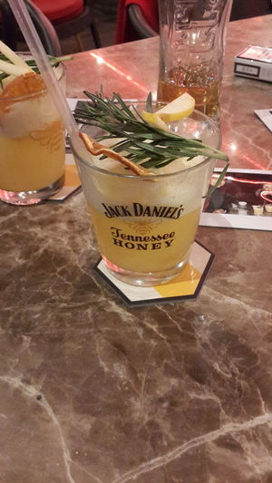 Jackdaniels Jennessee Honey Drink Drinking Glass Food And Drink Cocktail Refreshment Alcohol Indoors  Ice Cube Drinking Straw Cold Temperature Food Freshness