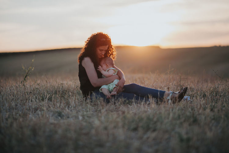 Family Matters Mother & Daughter Mother And Son Motherhood Positive Baby ❤ Babyhood Beautiful Woman Casual Clothing Family With One Child Fragility Full Length Land Leisure Activity Lifestyles Nature Positive Emotion Sitting Sky Sunset