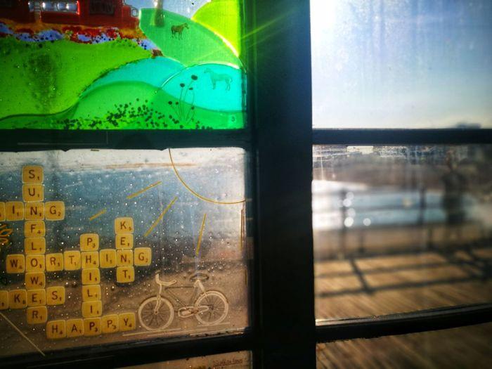 Stained glass art on Worthing Pier Scrabble Tiles Scrabble Scrabble Art Bike Green Color Blue Beach Beachphotography Window Water Text Close-up Sky
