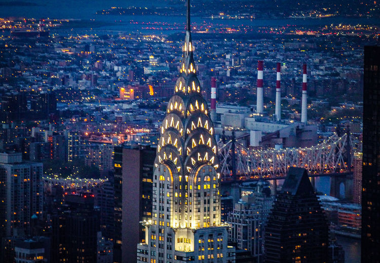 The chrysler building, new york, illuminated during a busy weekday evening. captured from the top of