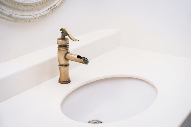 Low angle view of faucet in bathroom