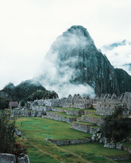 The moment you enter Machu Picchu Discover Your City Morning Aguas Calientes Ancient Civilization Archaeology Architecture Building Exterior Built Structure Clouds Day Explore Fog Grass History Huayna Picchu Mist Moody Mountain Mountain Peak Nature No People Outdoors The Past Tranquil Scene Travel Destinations