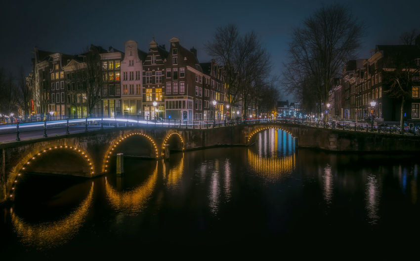 Amsterdam Remo SCarfo Built Structure Water Architecture Illuminated Reflection Night Bridge Building Exterior River Connection Bridge - Man Made Structure Transportation No People City Arch Bridge Nature Waterfront Tree Sky Outdoors EueEmNewHere EyeEm Selects EyeEm Gallery