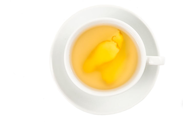 Refreshing and healthy ginger drinks Ginger Tea Tea Breakfast Crockery Cup Cut Out Directly Above Drink Food Food And Drink Freshness Ginger Healthy Eating Hot Drink Indoors  Mug No People Refreshing Refreshment Studio Shot Tea Tea - Hot Drink Tea Cup Wellbeing White Background