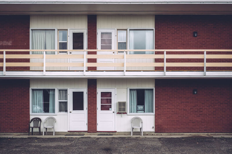 Chairs Doors Motel Old Buildings Outside Parking Lot Pavement Railing Red Brick Street Photography