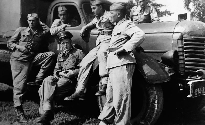 The soldiers, Poland. Men Medium Group Of People Street Full Length Transportation Lifestyles Sitting Mode Of Transport Togetherness Person Outdoors Day Old Times Blackandwhite Soldier Young Adult War Old Time Past