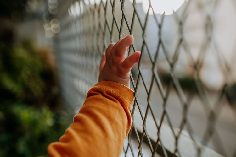 Baby Hand Hand Body Part Backgrounds Child Fence Security Barrier Balcony Human Hand Boundary Chainlink Fence Selective Focus One Person Metal Protection Human Body Part Safety Close-up Holding Outdoors Day Real People Finger Sky Sunset My Best Photo