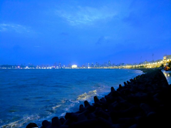 MarinedriveMumbai Sea Beach Water Outdoors Blue Sky No People Nature Sand Architecture Vacations Travel Destinations Built Structure Building Exterior Night City Nautical Vessel Beauty In Nature Groyne Horizon Over Water