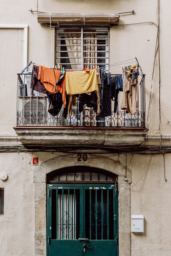 Barcelona City City Life SPAIN The Street Photographer - 2018 EyeEm Awards The Traveler - 2018 EyeEm Awards Architecture Built Structure Clothesline Clothing Drying Hanging House Laundry Low Angle View Residential District Street Street Photography Streetphotography Travel Destinations Urban Life Window