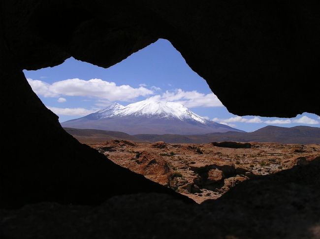 Snow-capped Andean mountain through a crack in the rocks Andes Beauty In Nature Bolivia Day Landscape Mountain Mountain Peak Natural Frame Natural Framing Nature No People Outdoors Physical Geography Scenics Sky Snow Capped Mountains Snowcapped Snowcapped Mountain Travel Travel Destinations Uyuni Fresh On Eyeem