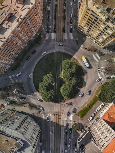Top down view of tram rails in the roundabout Drone Photograph DJI Mavic Air DJI X Eyeem City Architecture Building Exterior Built Structure Street Road High Angle View Nature Sign City Street Motor Vehicle Land Vehicle Mode Of Transportation No People Building Aerial View Outdoors Transportation Day Car 17.62°