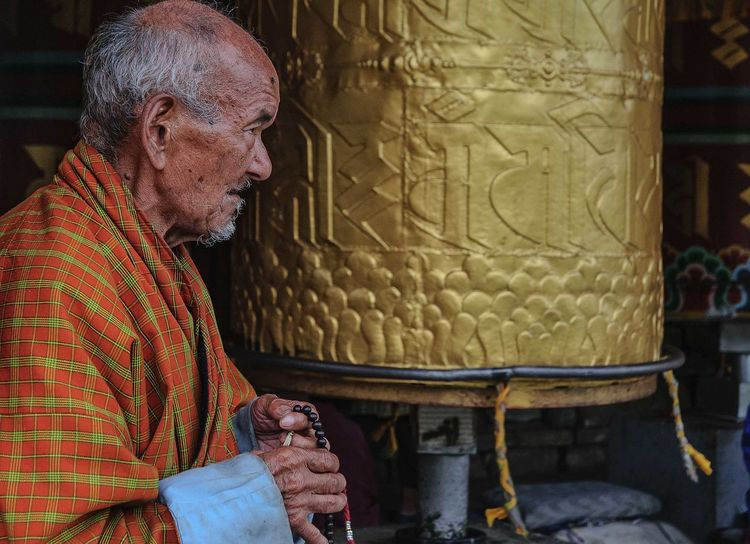 Bhutan Thimphu Adult Adults Only Bhutan Bhutanese Culture Day Indoors  Men One Man Only One Person One Senior Man Only Only Men People Praying Wheel Senior Adult Working