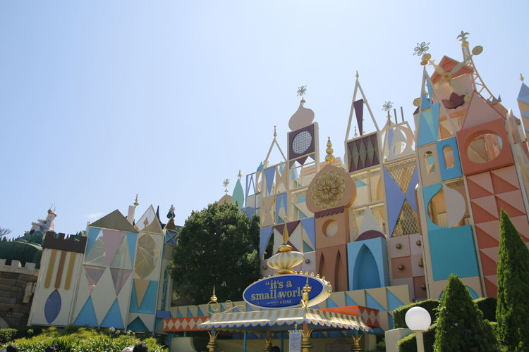 Low angle view of amusement park against clear sky