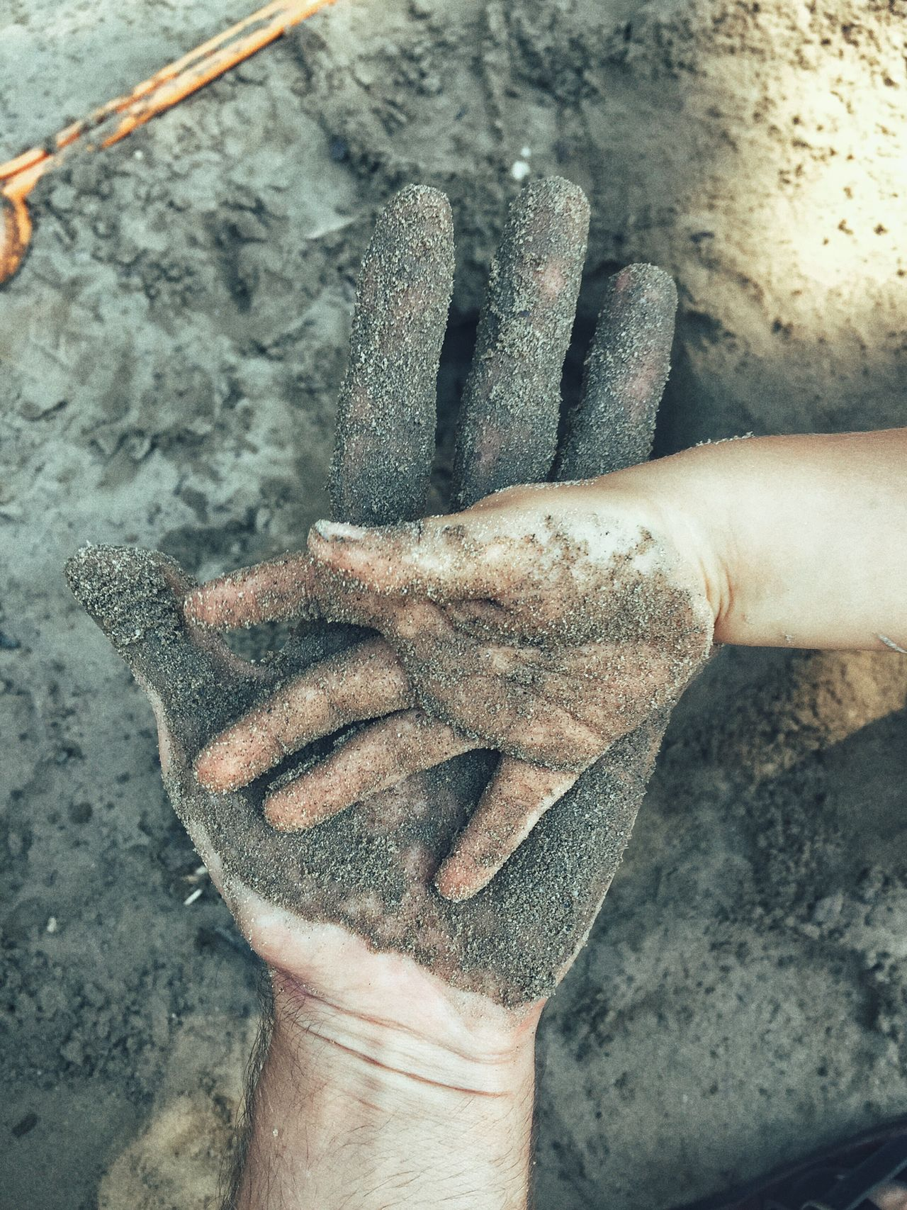 CLOSE-UP OF HUMAN HAND HOLDING CAMERA