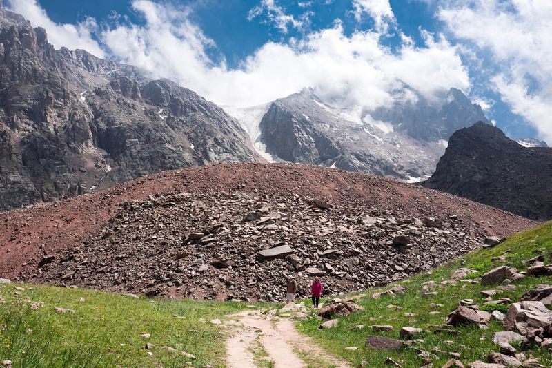 Mountain Hiking Mountain Range Nature Rock - Object Full Length Adventure Landscape Day Outdoors Beauty In Nature One Person Cloud - Sky Sky Scenics Real People Standing Rocky Mountains Physical Geography Snow Rockfall Landslide Debris Flow