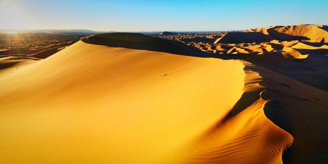 Scenic View Of Sahara Desert Against Sky At Merzouga