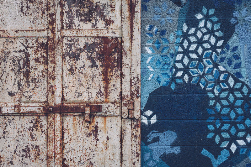 Architecture Blue Building Exterior Built Structure Closed Day Door Entrance Floral Pattern Full Frame Metal No People Old Outdoors Pattern Rusty Textured  Wall - Building Feature Weathered Window Wood - Material