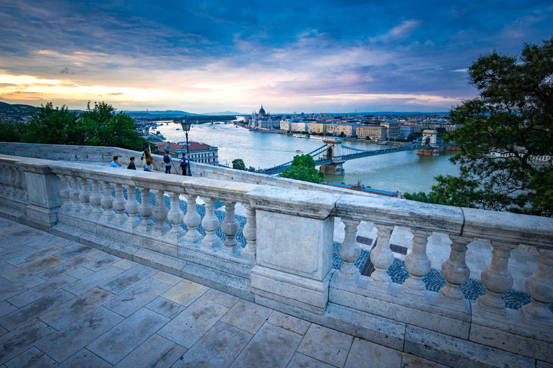View from Buda Castle Budapest Cityscape Railing River Danube Tourist View Bridge Chain Bridge Drmatic Sky Outdoors Parliament River Sky Sunset
