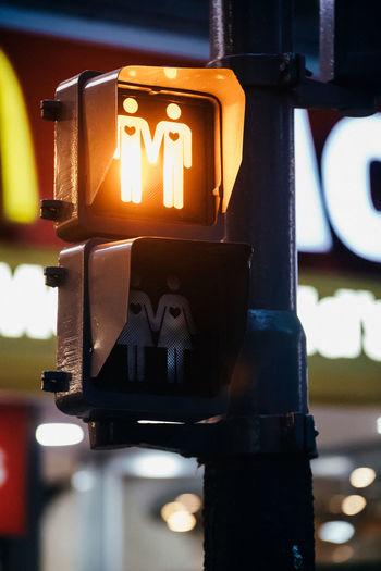 Close-up of illuminated pedestrian crossing sign