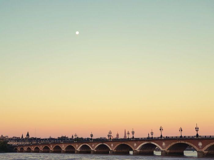 Arch bridge against sky during sunset