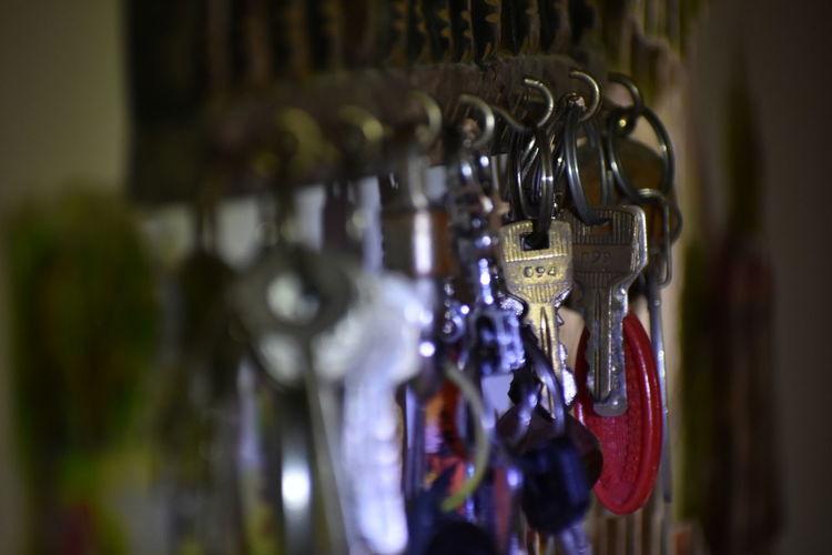 Close-up of keys hanging on rack