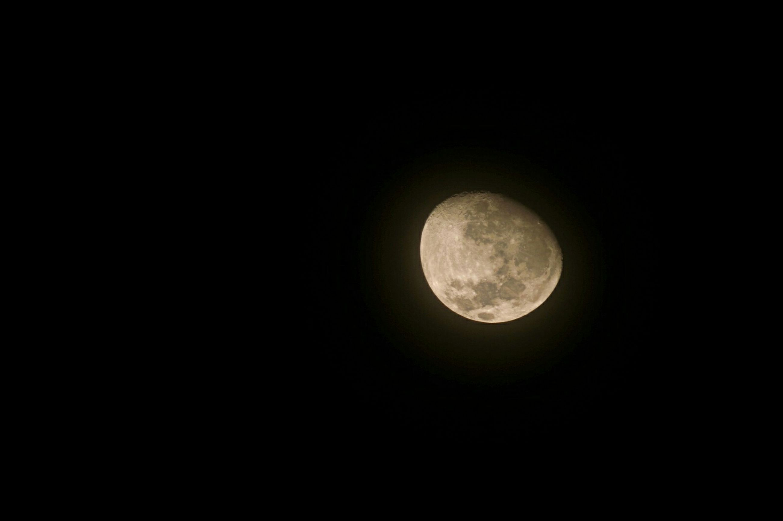 moon, astronomy, circle, night, full moon, planetary moon, beauty in nature, copy space, scenics, dark, tranquil scene, tranquility, low angle view, moon surface, nature, sky, majestic, space exploration, clear sky, idyllic