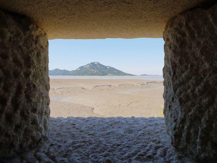강화도 돈대 Clear Sky Desert Sand Sunlight Arid Climate Window Ancient Stone Material Mountain Sky