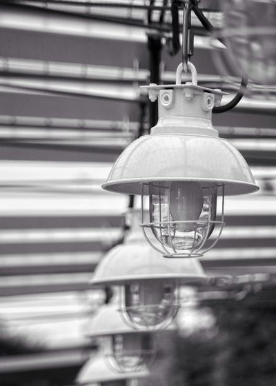 View of light bulb hanging from ceiling