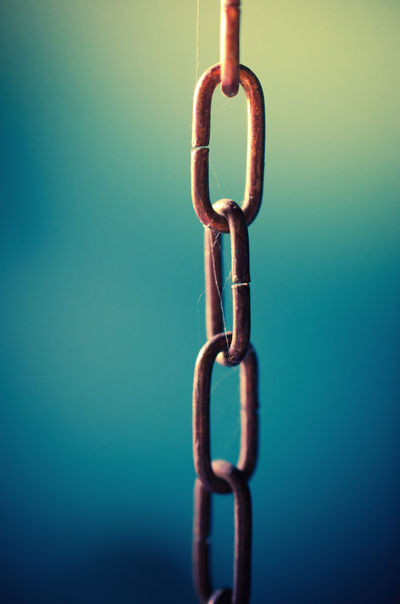 Chained Industry Life Security Blue Blue Background Chain Chained Chains Close-up Colored Background Connection Copy Space Hanging Hook Indoors  Metal No People Rusty Safety Security Still Life Strength Wall - Building Feature The Still Life Photographer - 2018 EyeEm Awards