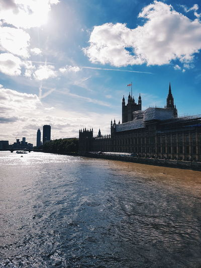 Palace Of Westminster By Thames River In City