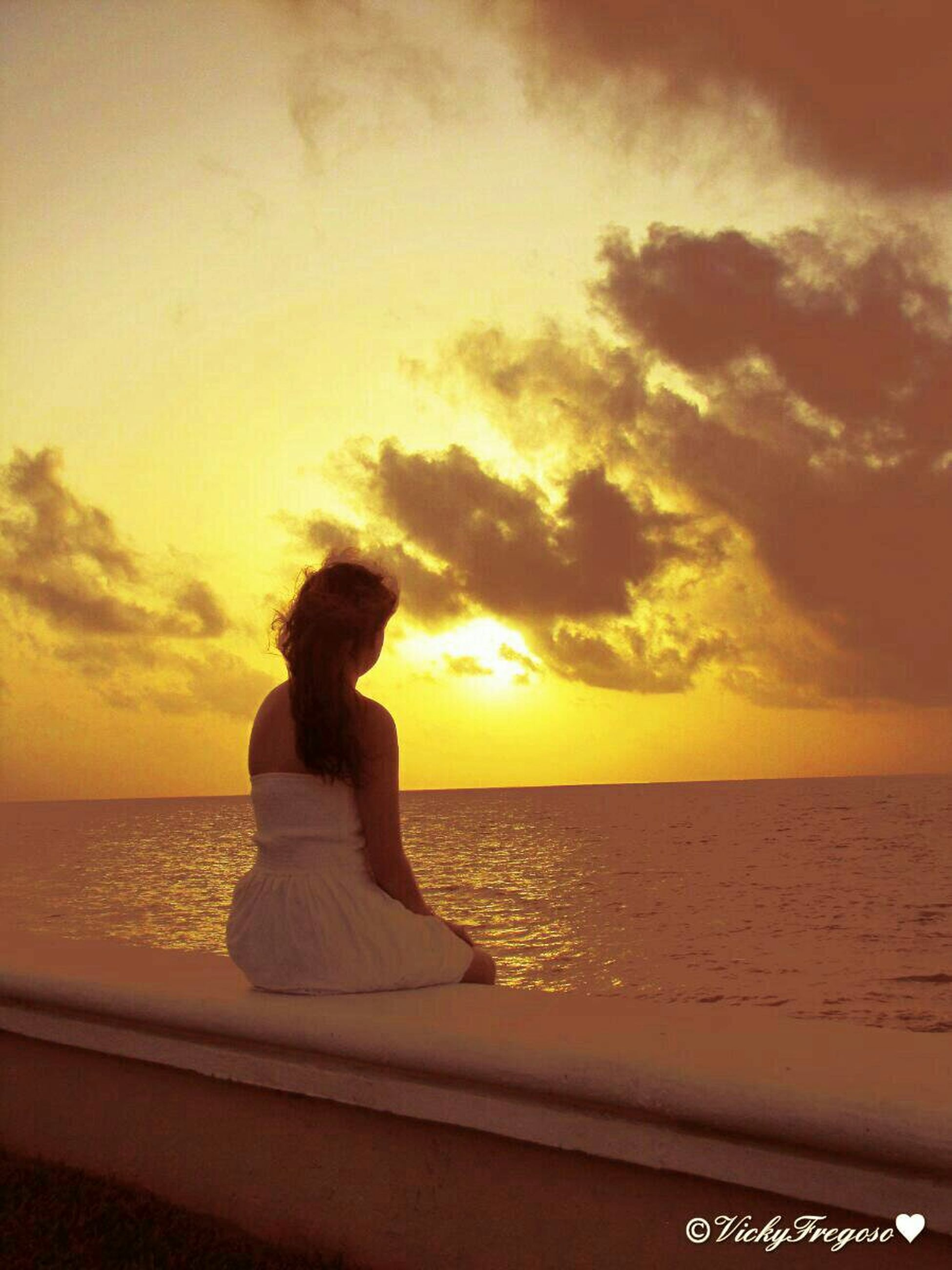 sunset, sea, water, horizon over water, sky, orange color, scenics, silhouette, beauty in nature, tranquil scene, tranquility, beach, idyllic, nature, cloud - sky, shore, rock - object, sitting