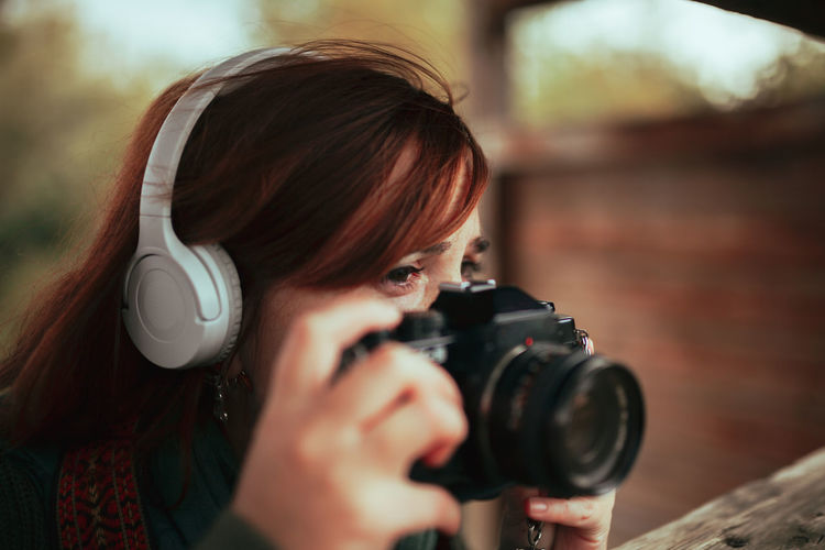 Close-up of woman photographing outdoors