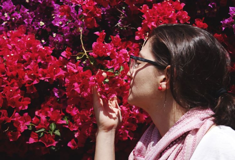 Woman smelling flowers in garden