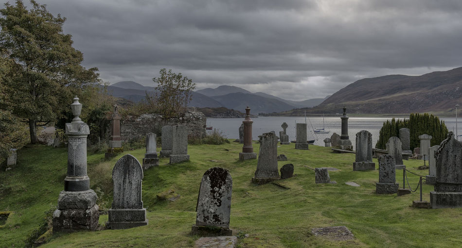 Grave Yard View Life & Death Ullapool Highlands Of Scotland Scenic View Day Cloud - Sky Sky Mountain Grave Cemetery Tombstone Stone Nature Plant The Past History Grass No People Memorial Tranquility Scenics - Nature Cross Mountain Range Outdoors Ancient Civilization Tranquil Scene Rocky Mountains Idyllic Gravestone Graveyard