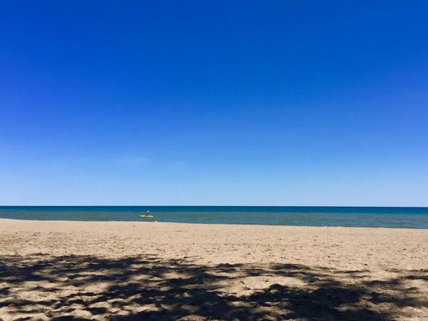 A lone Kayaker out on Lake Ontario this afternoon near Rouge Beach - IPhoneography Blue Sky Sandy Beach Blue Water