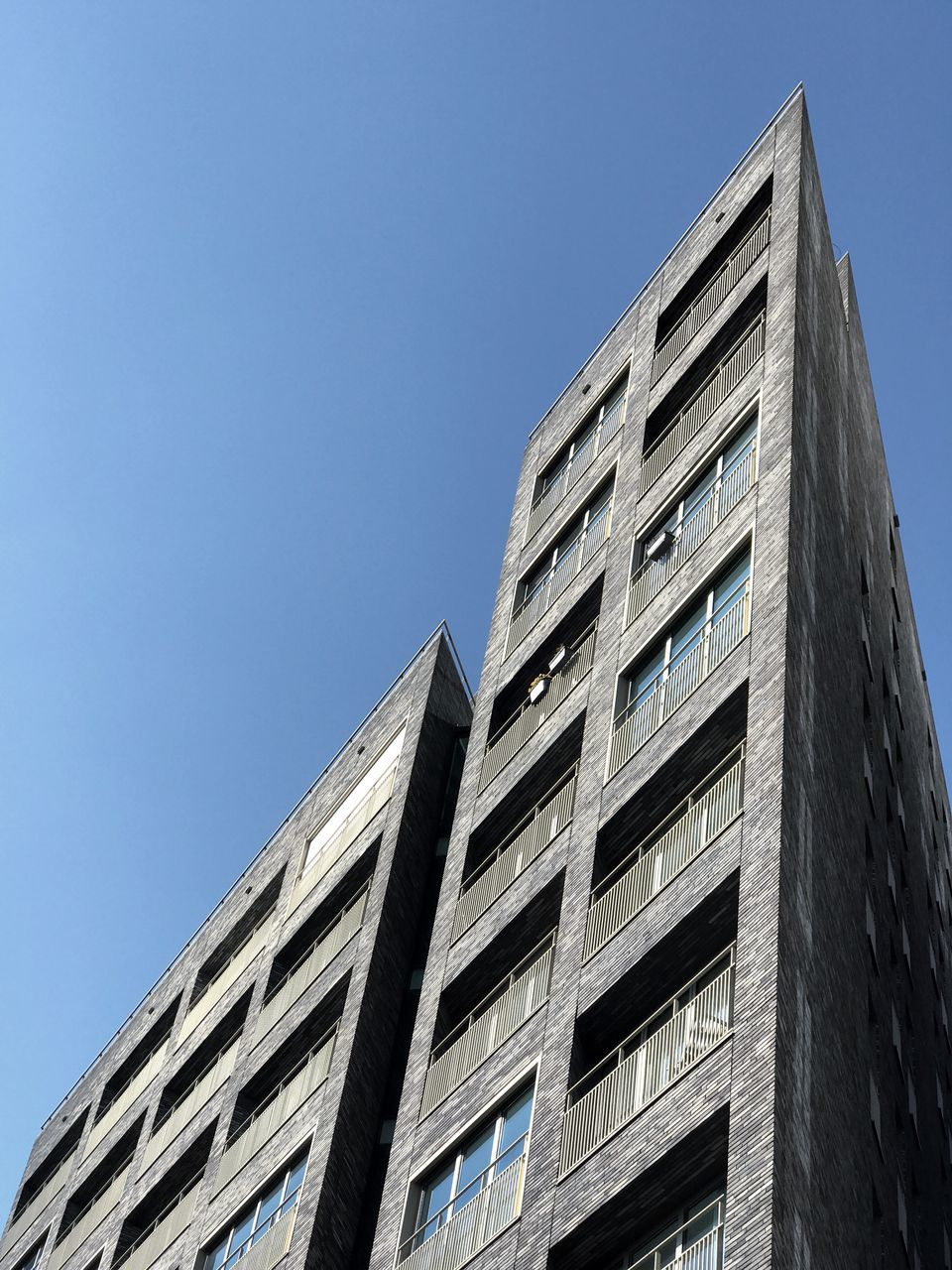 architecture, built structure, low angle view, building exterior, modern, day, clear sky, blue, skyscraper, outdoors, no people, sky, city