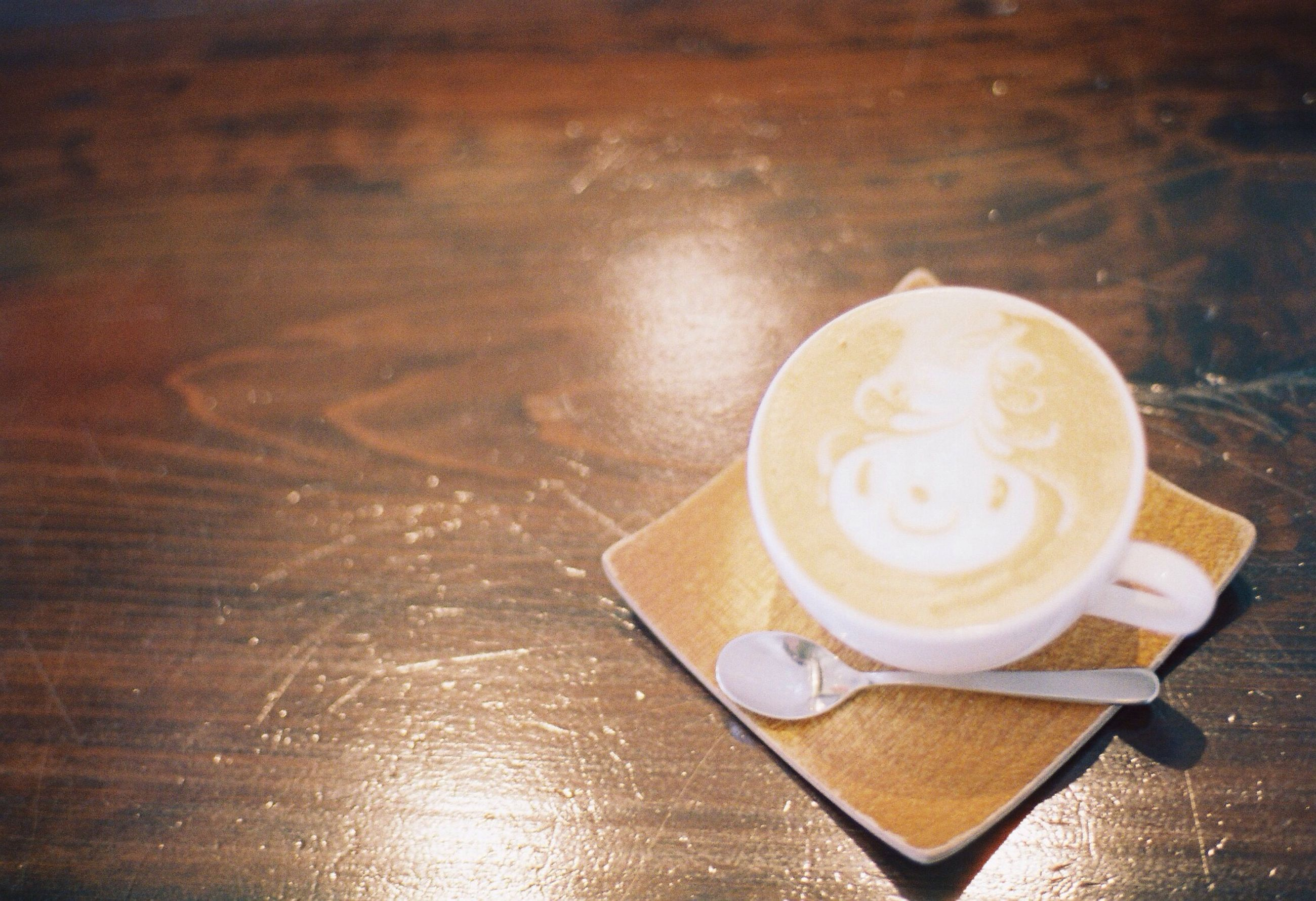 drink, coffee cup, food and drink, refreshment, coffee - drink, saucer, table, coffee, frothy drink, indoors, freshness, cappuccino, cup, still life, spoon, froth art, high angle view, beverage, hot drink, close-up
