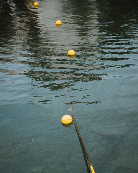 Yellow floating on water in lake