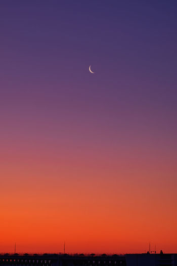 Scenic view of moon against sky during sunset