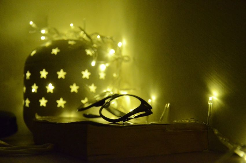 Reading a book Book Reading Relaxing Wintertime Indoors  Electricity  Night No People Home Interior Close-up Light Effect Luminosity Glasses Black Glasses