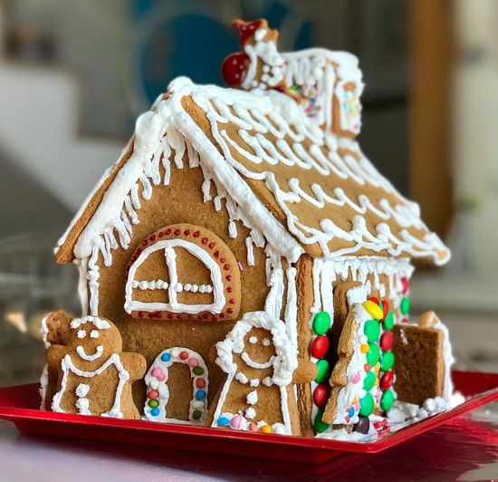 Childhood Cookies Gingerbread Cookie Gingerbread House Christmas Decoration Gingerbread House Celebration Focus On Foreground Table Christmas Close-up Indoors  No People Christmas Ornament Holiday - Event Sweet Food Art And Craft